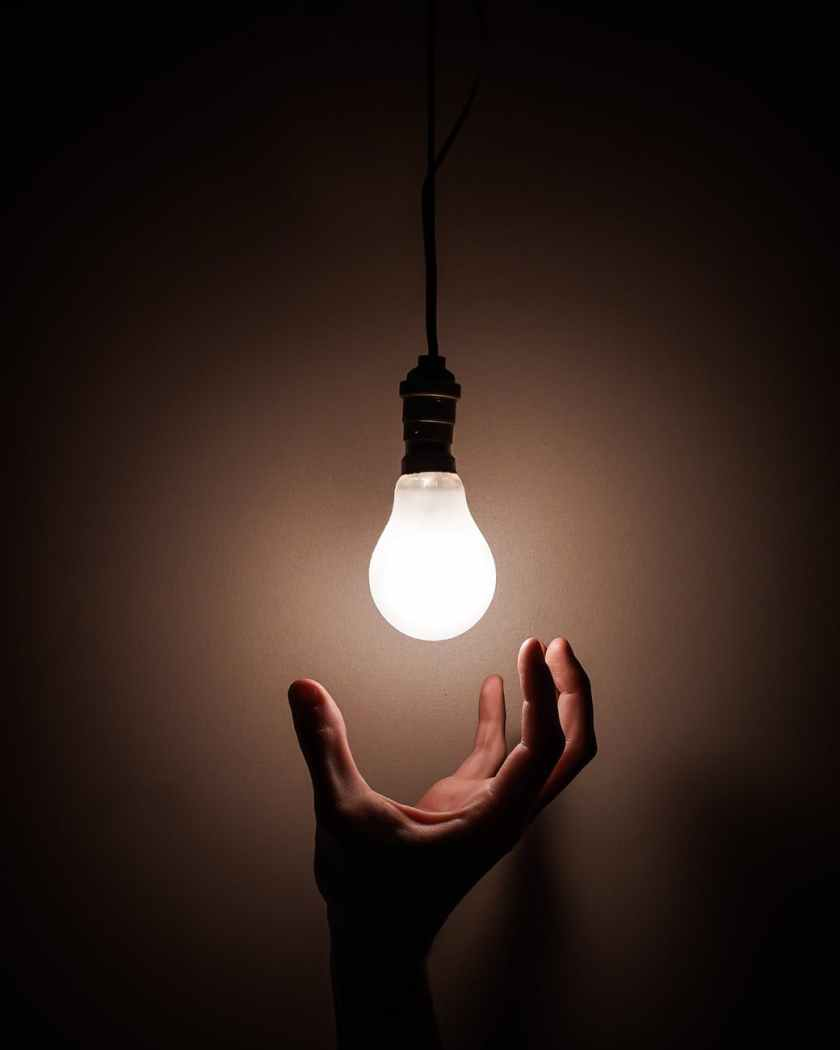 person holding white light bulb